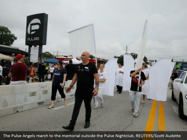 The Pulse Angels march to the memorial outside the Pulse Nightclub. REUTERS/Scott Audette