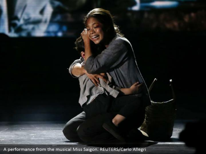 A performance from the musical Miss Saigon. REUTERS/Carlo Allegri