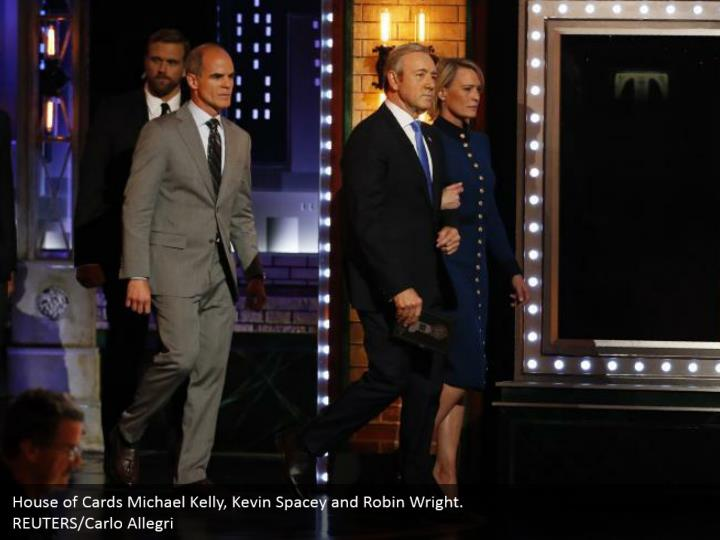 House of Cards Michael Kelly, Kevin Spacey and Robin Wright.  REUTERS/Carlo Allegri