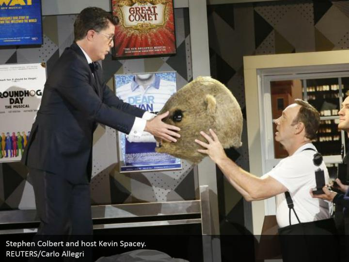 Stephen Colbert and host Kevin Spacey.  REUTERS/Carlo Allegri