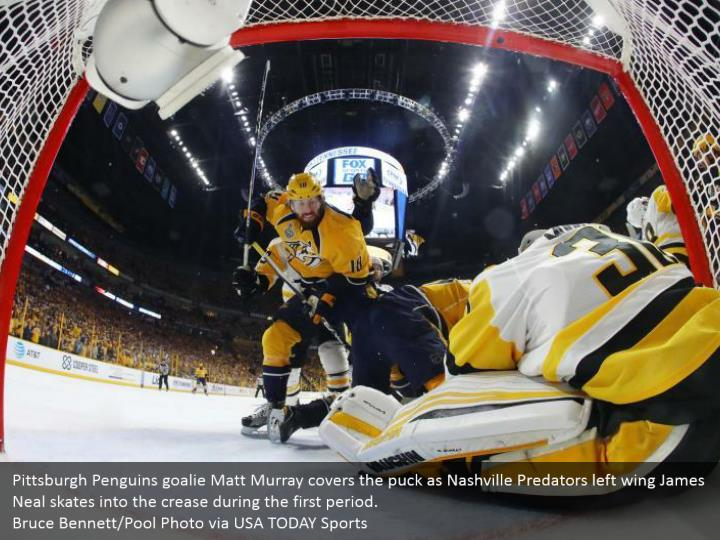 Pittsburgh Penguins goalie Matt Murray covers the puck as Nashville Predators left wing James Neal skates into the crease during the first period.  Bruce Bennett/Pool Photo via USA TODAY Sports