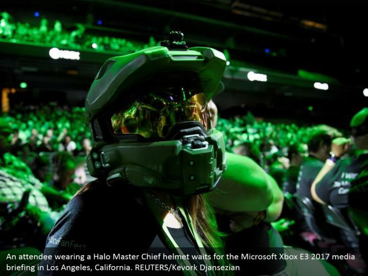 An attendee wearing a Halo Master Chief helmet waits for the Microsoft Xbox E3 2017 media briefing in Los Angeles, California. REUTERS/Kevork Djansezian