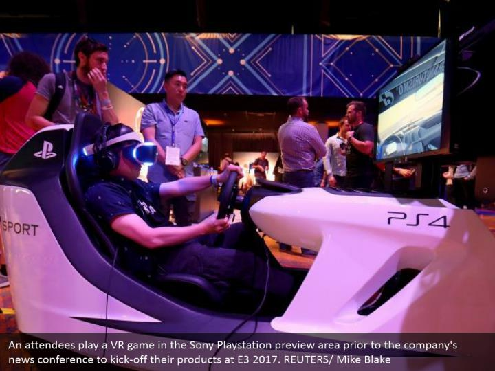 An attendees play a VR game in the Sony Playstation preview area prior to the company's news conference to kick-off their products at E3 2017. REUTERS/ Mike Blake