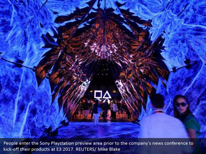 People enter the Sony Playstation preview area prior to the company's news conference to kick-off their products at E3 2017. REUTERS/ Mike Blake