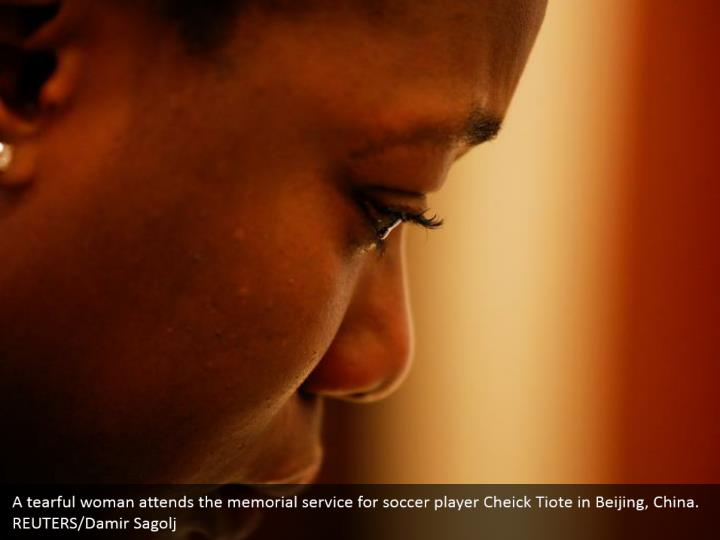 A tearful woman attends the memorial service for soccer player Cheick Tiote in Beijing, China. REUTERS/Damir Sagolj