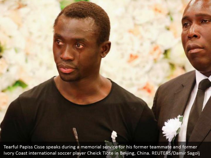 Tearful Papiss Cisse speaks during a memorial service for his former teammate and former Ivory Coast international soccer player Cheick Tiote in Beijing, China. REUTERS/Damir Sagolj