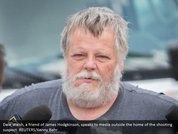 Dale Walsh, a friend of James Hodgkinson, speaks to media outside the home of the shooting suspect. REUTERS/Kenny Bahr