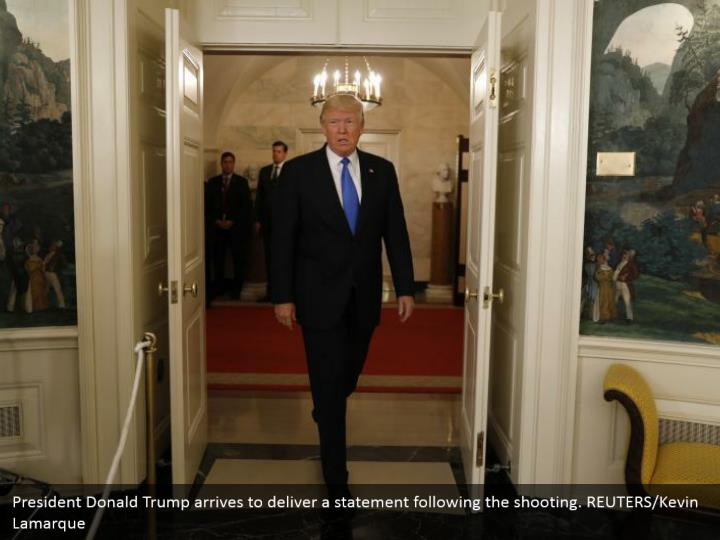 President Donald Trump arrives to deliver a statement following the shooting. REUTERS/Kevin Lamarque