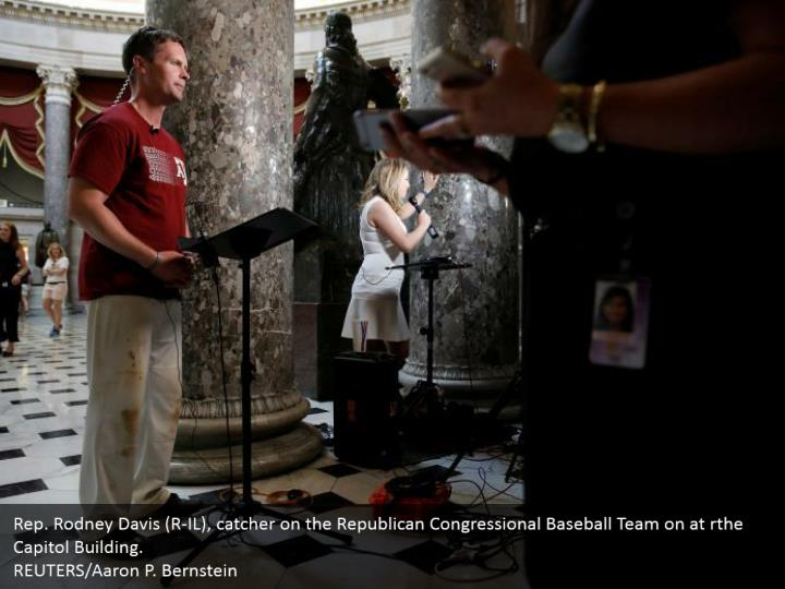 Rep. Rodney Davis (R-IL), catcher on the Republican Congressional Baseball Team on at rthe Capitol Building.  REUTERS/Aaron P. Bernstein