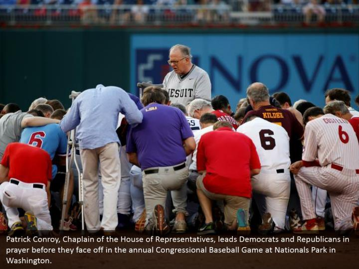 Patrick Conroy, Chaplain of the House of Representatives, leads Democrats and Republicans in prayer before they face off in the annual Congressional Baseball Game at Nationals Park in Washington.