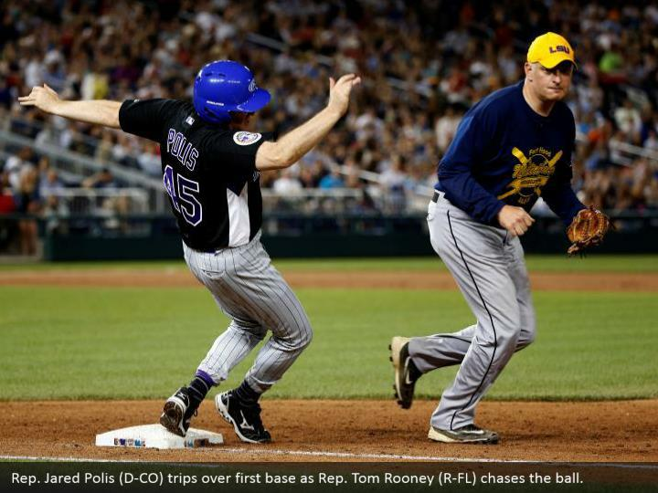 Rep. Jared Polis (D-CO) trips over first base as Rep. Tom Rooney (R-FL) chases the ball.