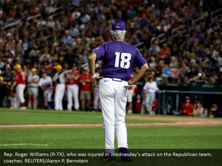 Rep. Roger Williams (R-TX), who was injured in Wednesday's attack on the Republican team, coaches. REUTERS/Aaron P. Bernstein