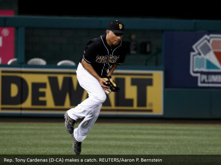 Rep. Tony Cardenas (D-CA) makes a catch. REUTERS/Aaron P. Bernstein