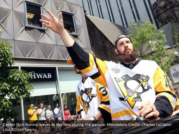 Center Nick Bonino waves to the fans during the parade. Mandatory Credit: Charles LeClaire-USA TODAY Sports