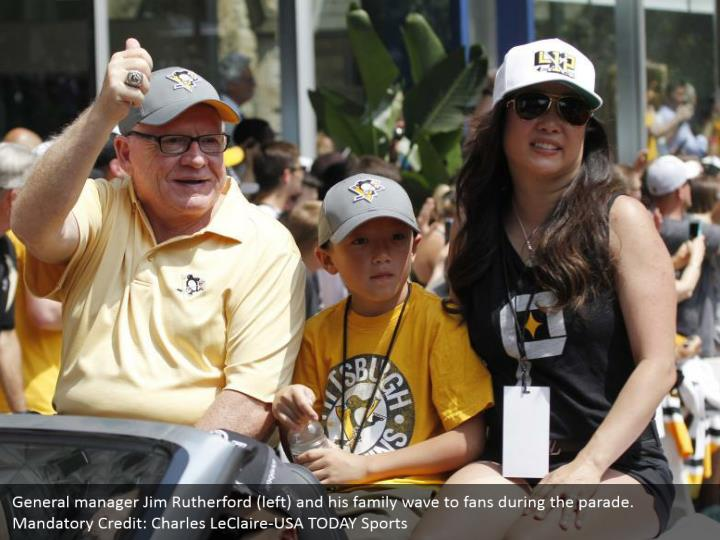 General manager Jim Rutherford (left) and his family wave to fans during the parade. Mandatory Credit: Charles LeClaire-USA TODAY Sports