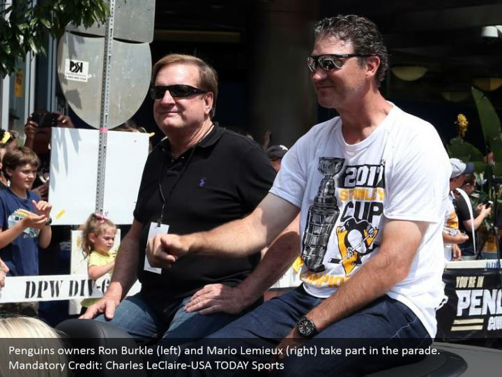 Penguins owners Ron Burkle (left) and Mario Lemieux (right) take part in the parade. Mandatory Credit: Charles LeClaire-USA TODAY Sports