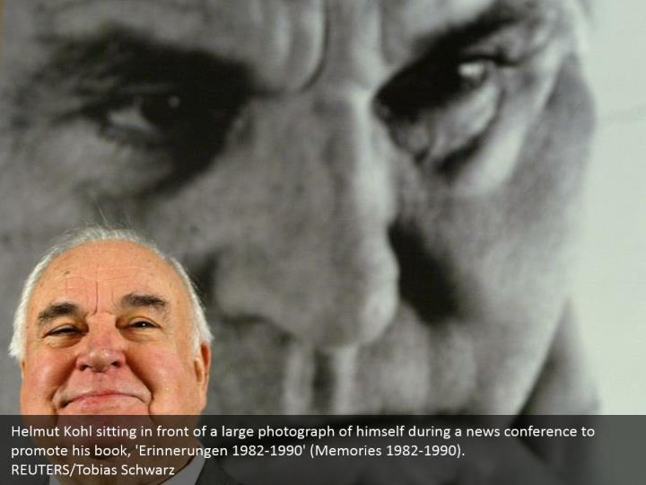 Helmut Kohl sitting in front of a large photograph of himself during a news conference to promote his book, 'Erinnerungen 1982-1990' (Memories 1982-1990).  REUTERS/Tobias Schwarz