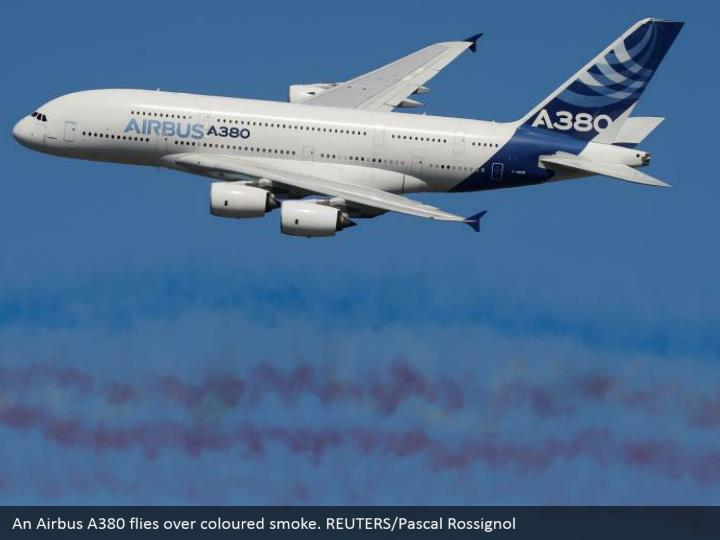An Airbus A380 flies over coloured smoke. REUTERS/Pascal Rossignol