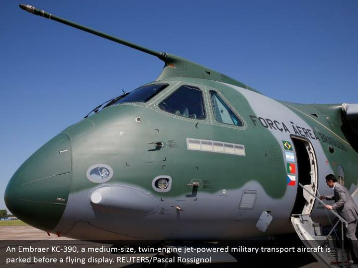 An Embraer KC-390, a medium-size, twin-engine jet-powered military transport aircraft is parked before a flying display. REUTERS/Pascal Rossignol