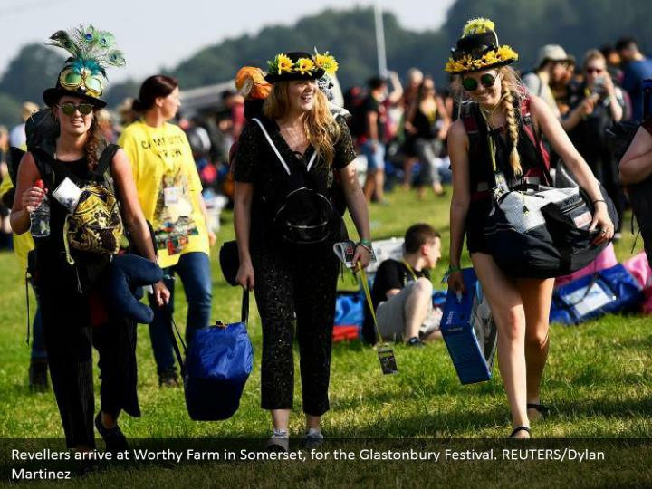 Revellers arrive at Worthy Farm in Somerset, for the Glastonbury Festival. REUTERS/Dylan Martinez