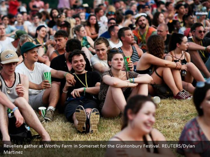 Revellers gather at Worthy Farm in Somerset for the Glastonbury Festival. REUTERS/Dylan Martinez