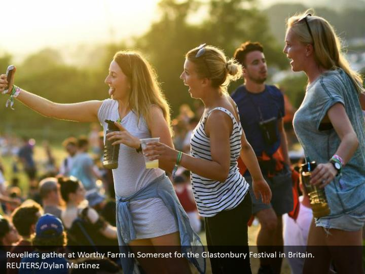 Revellers gather at Worthy Farm in Somerset for the Glastonbury Festival in Britain. REUTERS/Dylan Martinez