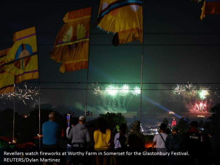 Revellers watch fireworks at Worthy Farm in Somerset for the Glastonbury Festival. REUTERS/Dylan Martinez
