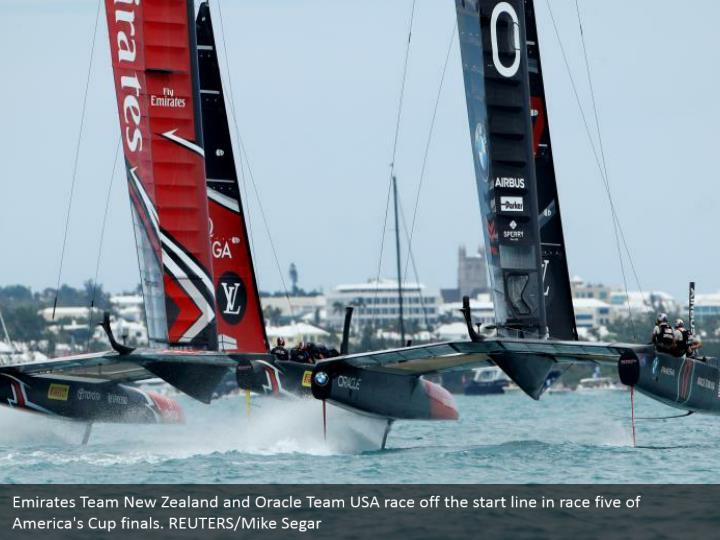 Emirates Team New Zealand and Oracle Team USA race off the start line in race five of America's Cup finals. REUTERS/Mike Segar