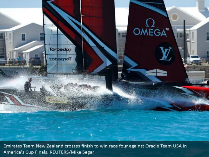 Emirates Team New Zealand crosses finish to win race four against Oracle Team USA in America's Cup Finals. REUTERS/Mike Segar