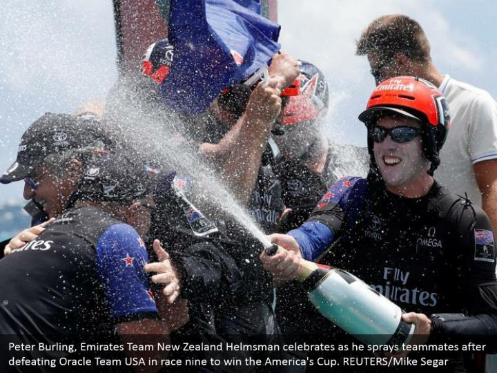 Peter Burling, Emirates Team New Zealand Helmsman celebrates as he sprays teammates after defeating Oracle Team USA in race nine to win the America's Cup. REUTERS/Mike Segar