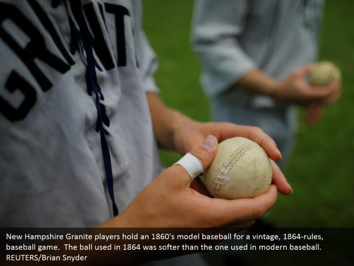 New Hampshire Granite players hold an 1860's model baseball for a vintage, 1864-rules, baseball game.  The ball used in 1864 was softer than the one used in modern baseball. REUTERS/Brian Snyder