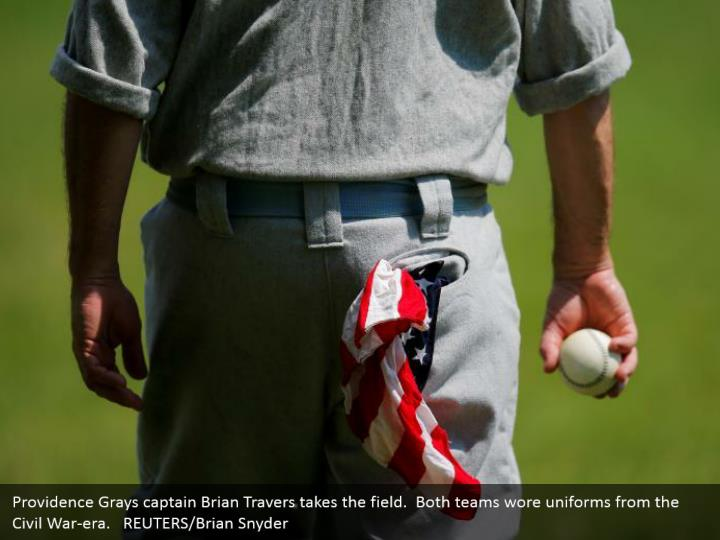 Providence Grays captain Brian Travers takes the field.  Both teams wore uniforms from the Civil War-era.   REUTERS/Brian Snyder