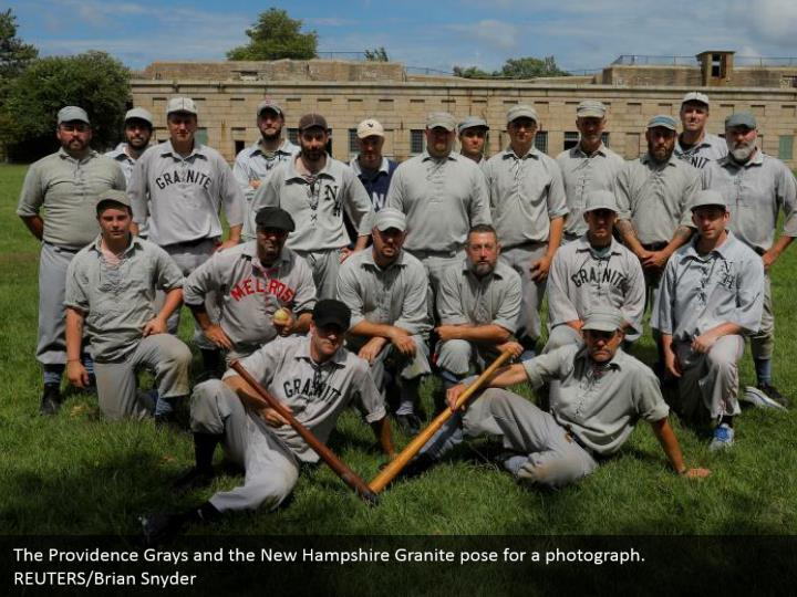 The Providence Grays and the New Hampshire Granite pose for a photograph.   REUTERS/Brian Snyder