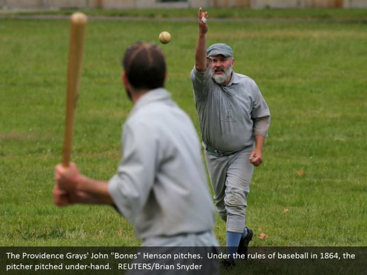"""The Providence Grays' John """"Bones"""" Henson pitches.  Under the rules of baseball in 1864, the pitcher pitched under-hand.   REUTERS/Brian Snyder"""