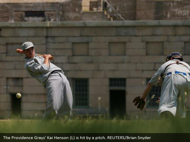 The Providence Grays' Kai Henson (L) is hit by a pitch. REUTERS/Brian Snyder