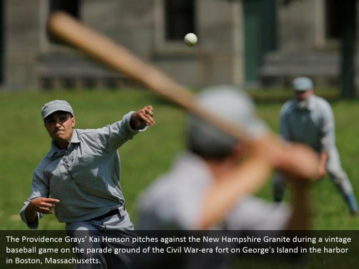 The Providence Grays' Kai Henson pitches against the New Hampshire Granite during a vintage baseball game on the parade ground of the Civil War-era fort on George's Island in the harbor in Boston, Massachusetts.