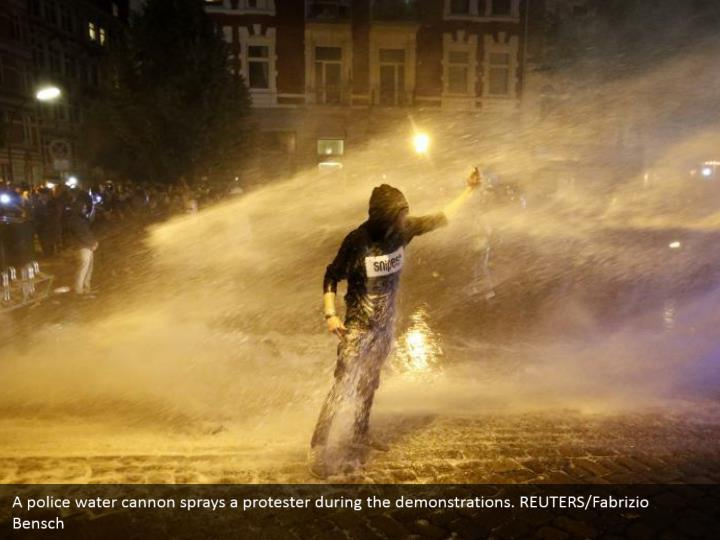 A police water cannon sprays a protester during the demonstrations. REUTERS/Fabrizio Bensch