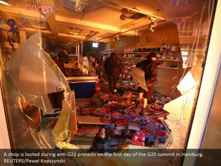 A shop is looted during anti-G20 protests on the first day of the G20 summit in Hamburg. REUTERS/Pawel Kopczynski