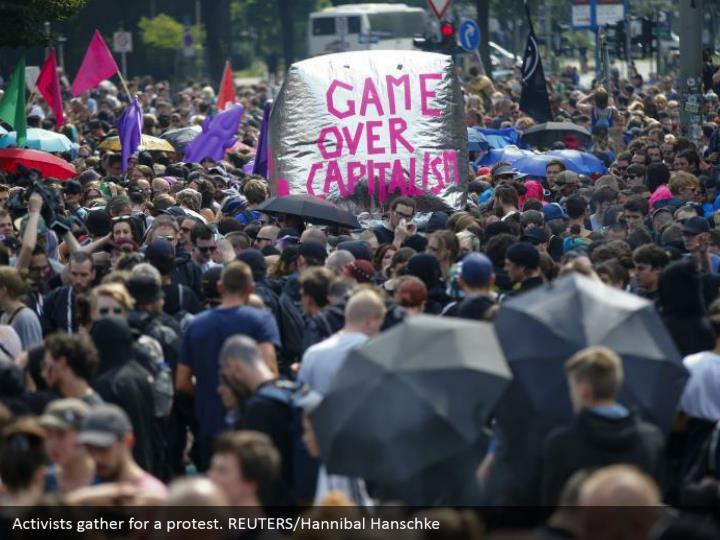 Activists gather for a protest. REUTERS/Hannibal Hanschke