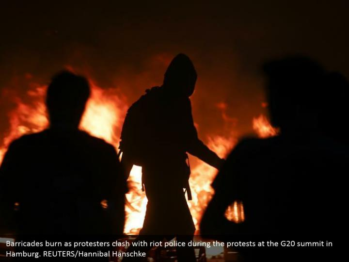Barricades burn as protesters clash with riot police during the protests at the G20 summit in Hamburg. REUTERS/Hannibal Hanschke