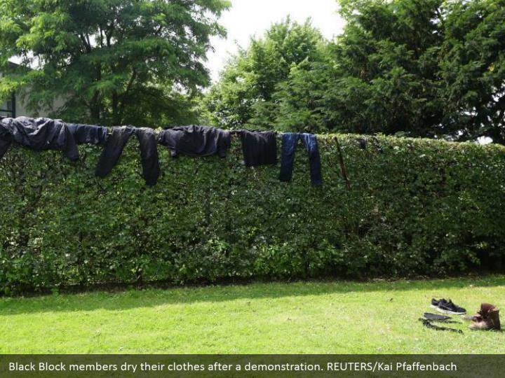Black Block members dry their clothes after a demonstration. REUTERS/Kai Pfaffenbach