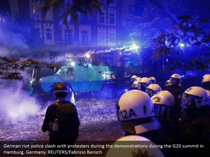 German riot police clash with protesters during the demonstrations during the G20 summit in Hamburg, Germany. REUTERS/Fabrizio Bensch