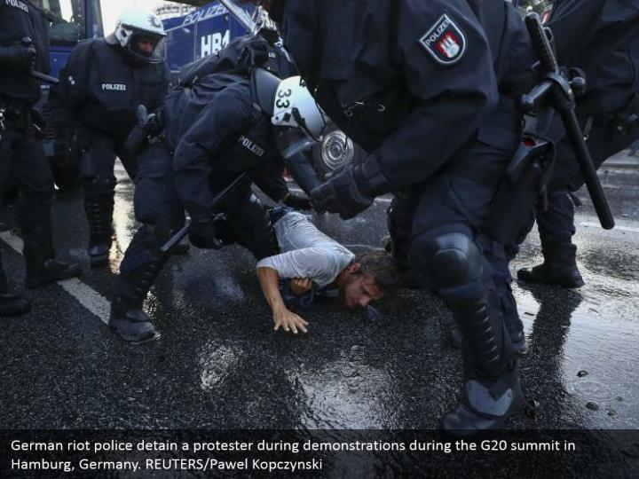 German riot police detain a protester during demonstrations during the G20 summit in Hamburg, Germany. REUTERS/Pawel Kopczynski