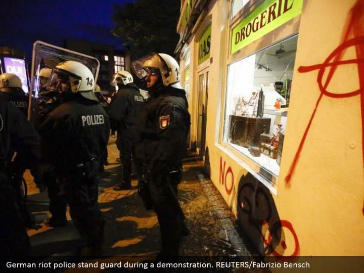 German riot police stand guard during a demonstration. REUTERS/Fabrizio Bensch