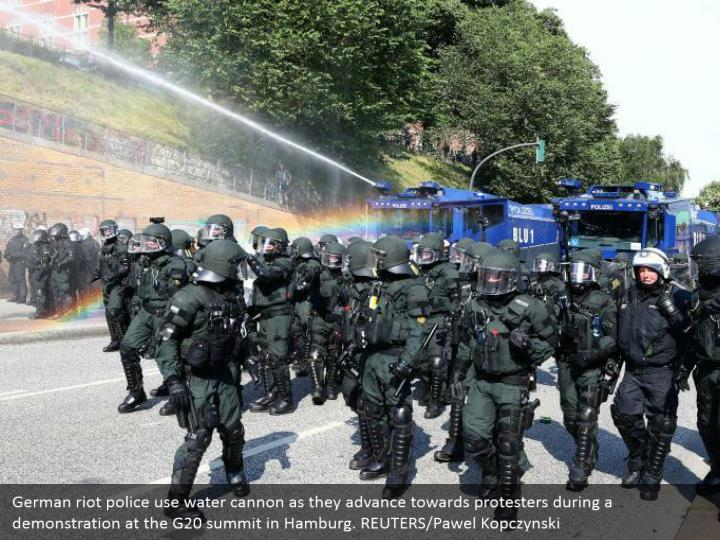 German riot police use water cannon as they advance towards protesters during a demonstration at the G20 summit in Hamburg. REUTERS/Pawel Kopczynski