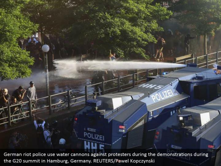 German riot police use water cannons against protesters during the demonstrations during the G20 summit in Hamburg, Germany. REUTERS/Pawel Kopczynski