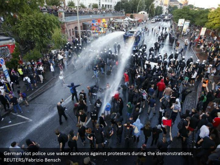 German riot police use water cannons against protesters during the demonstrations. REUTERS/Fabrizio Bensch