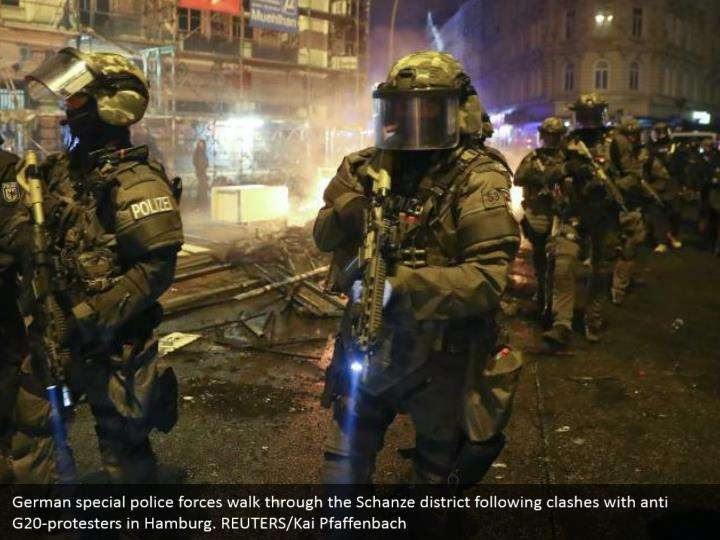 German special police forces walk through the Schanze district following clashes with anti G20-protesters in Hamburg. REUTERS/Kai Pfaffenbach