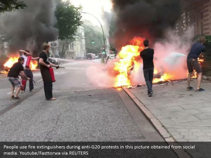 People use fire extinguishers during anti-G20 protests in this picture obtained from social media. Youtube/Fasttorwa via REUTERS