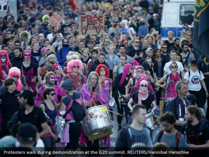 Protesters walk during demonstration at the G20 summit. REUTERS/Hannibal Hanschke